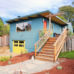 May2015-Trulia-10-High-Impact-Home-Improvements-You-Can-Do-For-Under-10K-or-Less-new-blue-home-with-yellow-door